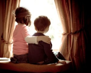 2 children at the window